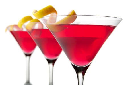 Close-up three cosmopolitan cocktails isolated on white background