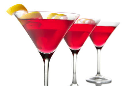 Closeup three cosmopolitan cocktails isolated on white background