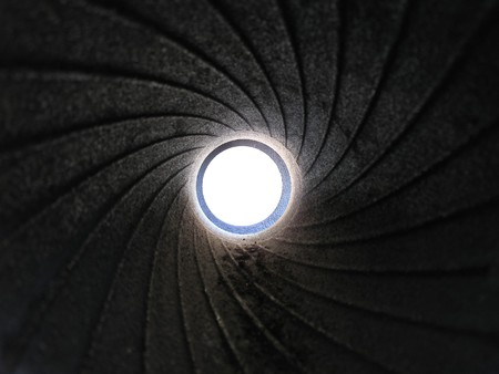 A view through the rusty muzzle of the gun. photo