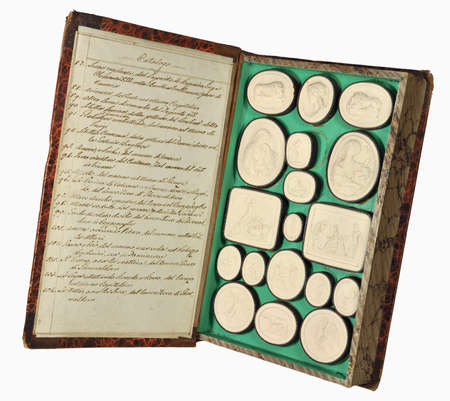 relievo: Old Italian book with  set of gypsum medallions Stock Photo