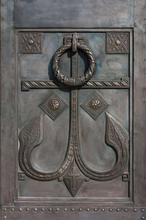 Russian orthodox temple door detail with the decorations and a Christian symbol in the form of an anchor Reklamní fotografie