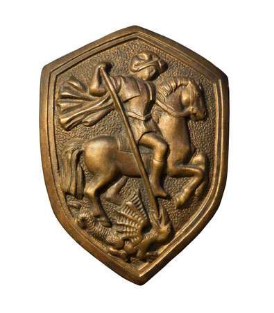 St. George killing the dragon. Bronze bas-relief on the shield. Isolated on white Stock Photo