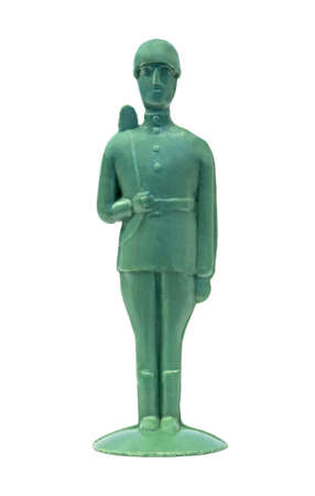 Retro plastic toy soldier with a gun by the shoulder isolated on white Reklamní fotografie