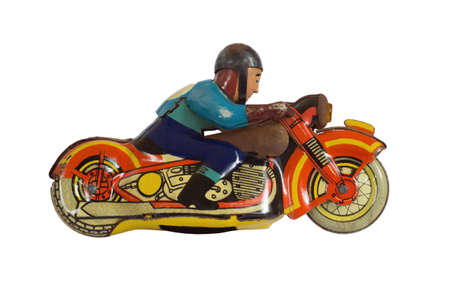 Motorcycle racer. Old clockwork toy. Isolated on white