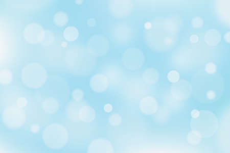 Abstract blue and white background with bokeh effect. Christmas defocused circle lights