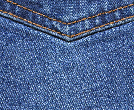 Blue jeans texture closeup, denim background