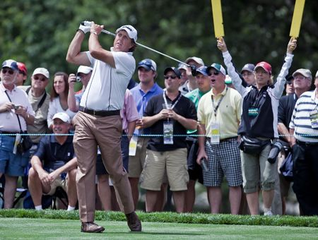 FARMINGDALE, NY - JUNE 17: Spectators enjoy watching Phil Mickelson hit a drive on the second hole at the black course during the 2009 US Open on June 17, 2009 in Farmingdale, NY. Editorial