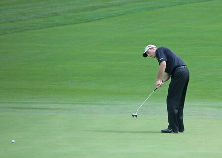FARMINGDALE, NY - JUNE 15: Jim Furyk putts on the 12th hole on the Black Course during the 2009 US Open on June 15, 2009 in Farmingdale, NY.  Editorial