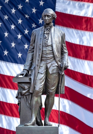 Isolated statue of George Washington, Independence Hall, Philadelphia, PA. The United States flag is in background. photo