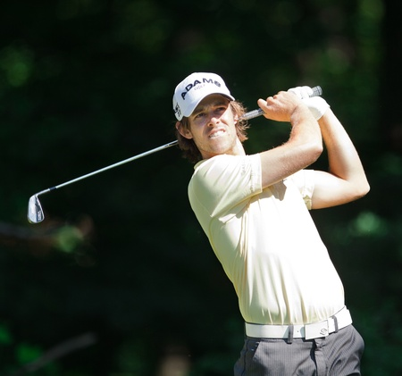 BETHESDA, MD - JUNE 15: Aaron Badeley hits a shot at Congressional during the 2011 US Open on June 15, 2011 in Bethesda, MD.
