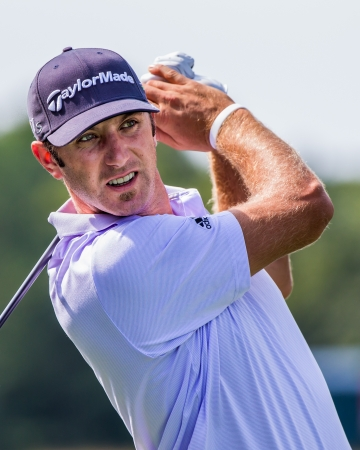FARMINGDALE, NY - AUGUST 21: Long Hitting Dustin Johnson hits a drive at Bethpage Black during the Barclays on August 21, 2012 in Farmingdale, NY. Editorial