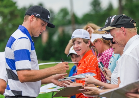 ARDMORE, PA  - June 11:  Nick Watney signs autographs at the 2013 US Open at Merion  on June 11, 2013 in Ardmore, PA Editorial