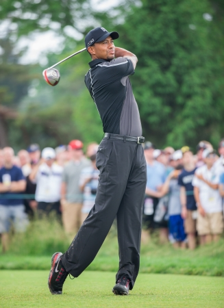 ARDMORE, PA  - June 11:  Tiger Woods hits a drive at the 2013 US Open at Merion  on June 11, 2013 in Ardmore, PA.