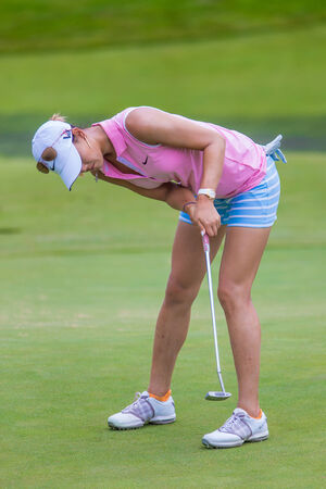 us open: Michelle Wie hits a putt at the 2013 US Open