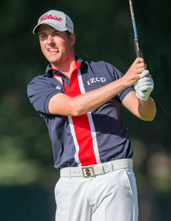 ARDMORE, PA USA- June 12, 2013: Web Simpson hits a drive at the 2013 US Open at Merion on June 12, 2013 in Ardmore, PA. Redakční