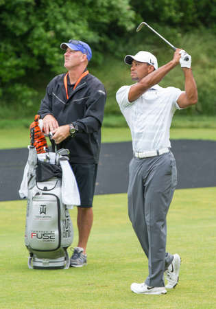 ARDMORE, PA USA- June 10, 2013: Golf great, Tiger Woods, hits a shot at the 2013 US Open at Merion on June 10, 2013 in Ardmore, PA.
