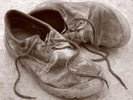 sepia toned worn out shoes