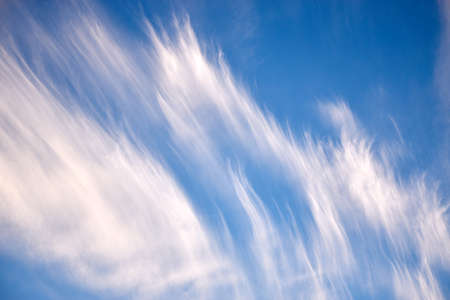 A photograph with majority frame filled with a few cirrus clouds
