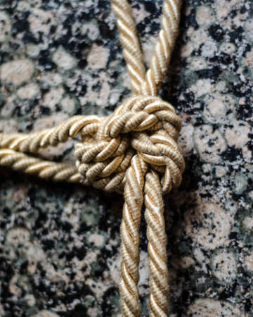 Knot of rope on marble table 스톡 콘텐츠
