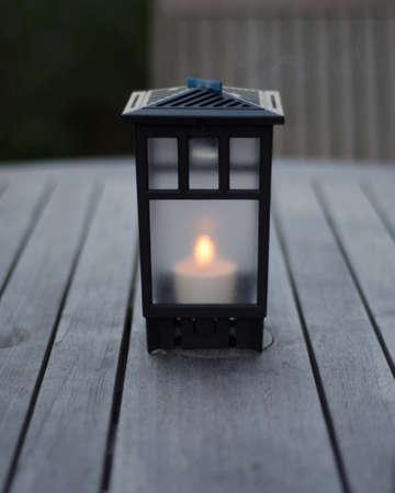 Metal Lantern on Wood Table Stock fotó