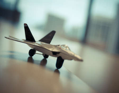 A toy model fighter jet on a desk