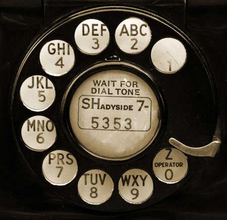phone: Clsoeup og retro telephone dial in sepia. Stock Photo