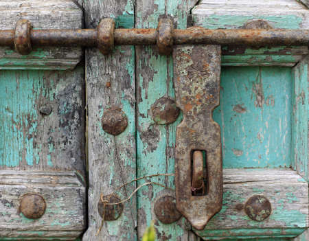 chipped: Antique lock on old door with blue chipped paint. Stock Photo