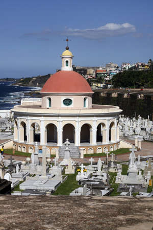 san juan: View of Old San Juan,Puerto Rico includes red domed building,old cemetery,ocean,houses,blue sky