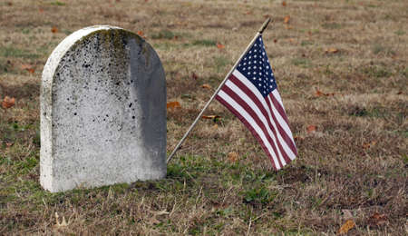 Old tombstone and American flag  photo