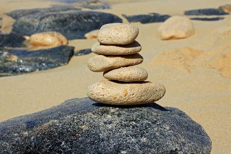 balanced rocks: Yoga style balanced rocks on the beach.