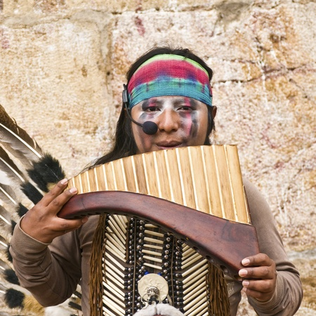 CUENCA, ECUADOR - MAY 27: Andean Indian plays traditional instrument on May 27, 2011 in Cuenca, Ecuador. Indigenous descendants are found in the towns of the Andes mountain range in South America.