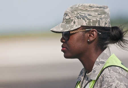 homestead: FLORIDA, USA - NOVEMBER 6: Air Force female soldier guards performance of Wings Over Homestead Event on November 6 2010 at Homestead, Fl. USA. This event takes place at the Homestead Air Force Base