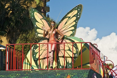 SANTO DOMINGO, DOMINICAN REPUBLIC - MARCH 6: Butterfly model waives at the Malecon Carnival on March 6, 2011 in Santo Domingo, Dominican Republic. Exotic customs can be seen at this annual event.