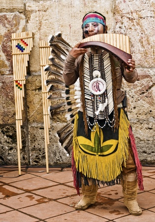 CUENCA, ECUADOR - MAY 27: Andean Indian plays traditional instruments on May 27, 2011 in Cuenca, Ecuador. Indigenous descendants are found in the towns of the Andes mountain range in South America. Stock Photo - 10023441