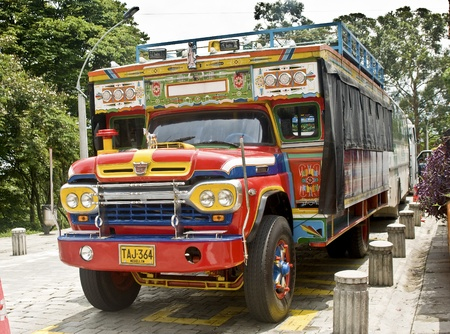 colombian: MEDELLIN, COLOMBIA - MAY 2: Chiva truck parked on Pueblito Paisa on May 2, 2010 in Medellin, Colombia. Chivas are very typical transportation vehicles in Colombia.