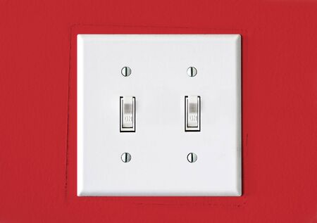 Double Light Switch on Red Wall