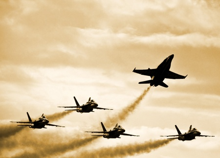 risk of war: Fighter Jets Splitting Formation Stock Photo