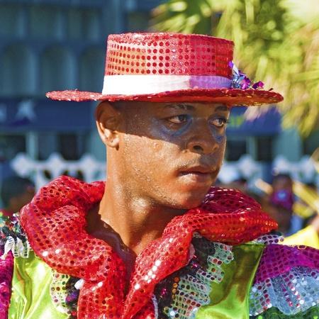 santo domingo: SANTO DOMINGO, DOMINICAN REPUBLIC - MARCH 6: Carnival dancer wearing exotic customs stares at public while sweating at the Malecon Carnival on March 6, 2011 in Santo Domingo, Dominican Republic.