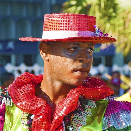 SANTO DOMINGO, DOMINICAN REPUBLIC - MARCH 6: Carnival dancer wearing exotic customs stares at public while sweating at the Malecon Carnival on March 6, 2011 in Santo Domingo, Dominican Republic.