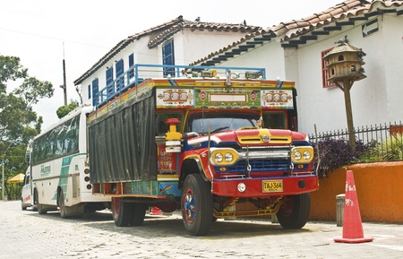 medellin: MEDELLIN, COLOMBIA - MAY 2: Chiva truck parked on Pueblito Paisa on May 2, 2010 in Medellin, Colombia. Chivas are very typical transportation vehicles in Colombia.
