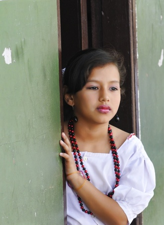 SANTA CRUZ, BOLIVIA- JUNE 7: Traditionally dressed young girl waits turn to perform in a folkloric dance on June 7, 2010 in Santa Cruz,  Bolivia. This event celebrates teachers day in Bolivian schools each year.