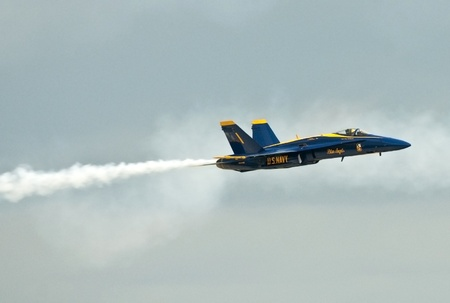 afterburner: FLORIDA, USA - NOVEMBER 6: Blue Angel across the sky during performance on Wings Over Homestead Show on November 6 2010 at Homestead, Fl. USA. This event takes place at the Homestead Air Force Base
