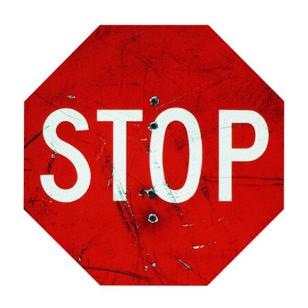 sign: Stop Sign Enforced with Bullet Holes Stock Photo