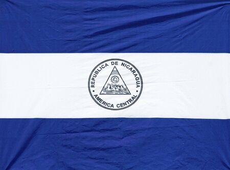 nicaraguan: Independence Day wrinkled Nicaraguan Flag with Emblem