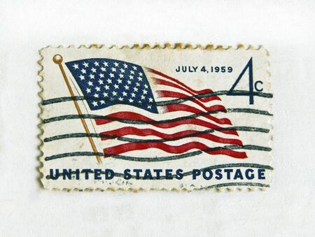 united states postal service: USA - CIRCA 1959: Independence commemorative stamp flaming the United States flag, circa 1959 Stock Photo