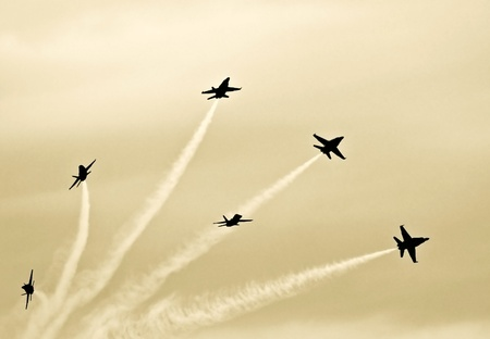 Silhouetted Jets Maneuvering in Formation