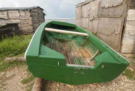 green boat: Green Boat on Shore Stock Photo