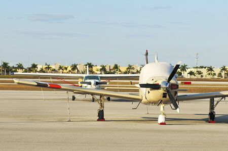 Parked Small Airplanes Frontal View photo
