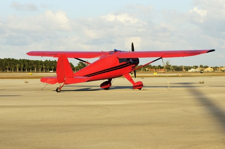 Small Red Airplane ready to Take Off Stock Photo - 13315907