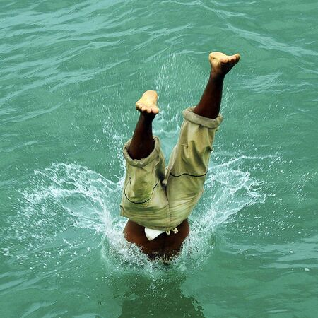 Unidentified Diver Jumping into the Ocean Stock Photo - 13633949